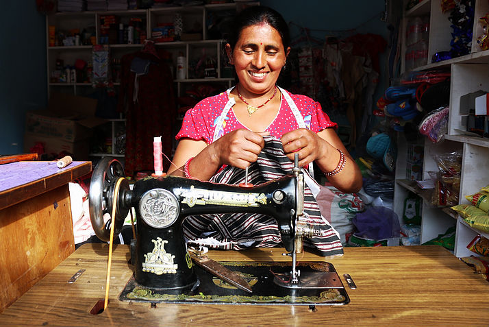 Sabitri sewing clothes is also a member of Jitpur cooperative